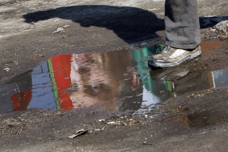 An election poster of Viktor Orban, leader of Hungarian opposition party Fidesz, is reflected in a puddle of water in central Budapest